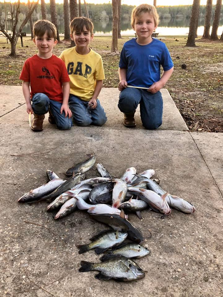 Left to Right: Kason Bozeman, Kolby Bozeman and Kolton Meeks recently had a successful day of fishing at Escambia County State Public Fishing Lake in Wing, Alabama.  Photo courtesy of Doug & Allie's Fishing Post at Escambia County State Public Fishing Lake (also known as Leon Brooks Hines Lake)