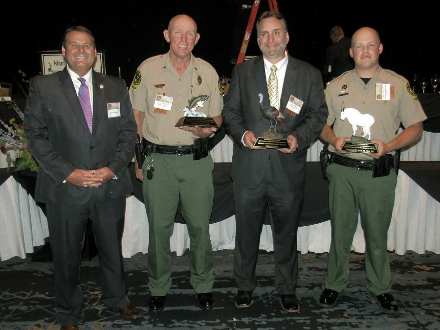 L-R: Conservation Commissioner Chris Blankenship, Wildlife and Freshwater Fisheries Director Chuck Sykes, Sergeant Alan Roach and Officer Richard M. Tait III.