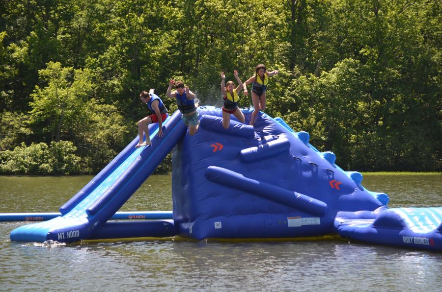 Swimmers prepare for splashdown after leaping from the new Flip Side Watersports inflatable 'Mt. Hood' at Oak Mountain State Park.