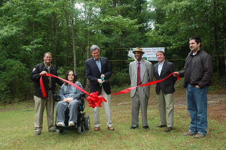 Dignitaries cut the ribbon to open the trail.